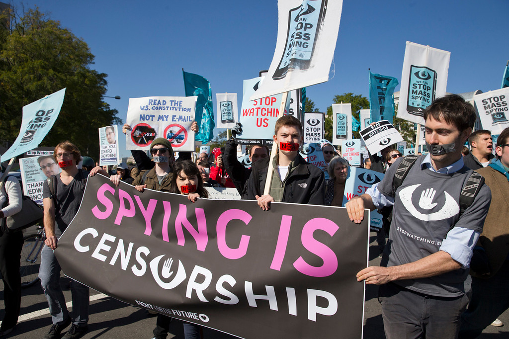 . Demonstrators march through Washington towards the National Mall for a rally to demand that Congress investigate the National Security Agency\'s mass surveillance programs Saturday, Oct. 26, 2013. ( AP Photo/Jose Luis Magana)
