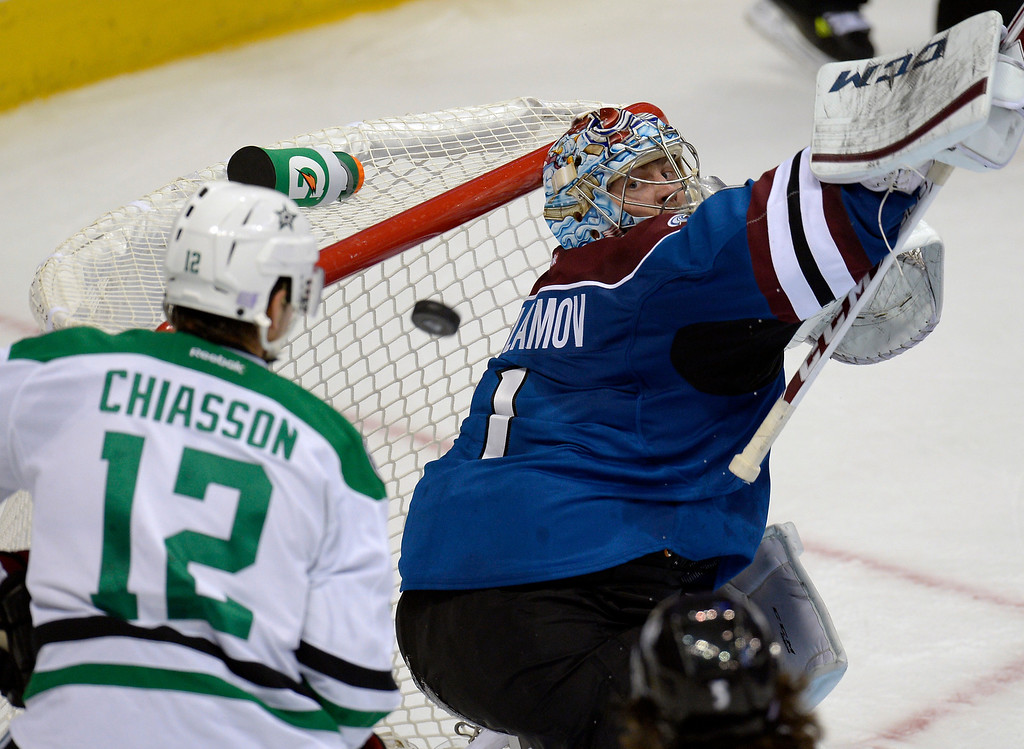 . DENVER, CO - OCTOBER 15: Colorado Avalanche goalie Semyon Varlamov (1) makes a save in the second period as Dallas Stars right wing Alex Chiasson (12) looks on October 15, 2013 at Pepsi Center.(Photo By John Leyba/The Denver Post)