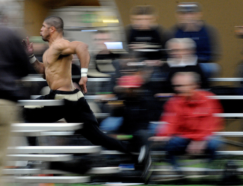 . Ray Polk runs one of his 40-yard dashes as scouts get his time on Wednesday. Scouts from around the NFL  tested and watched University of Colorado football players during CU pro timing day on Wednesday. (Cliff Grassmick/Boulder Daily Camera)