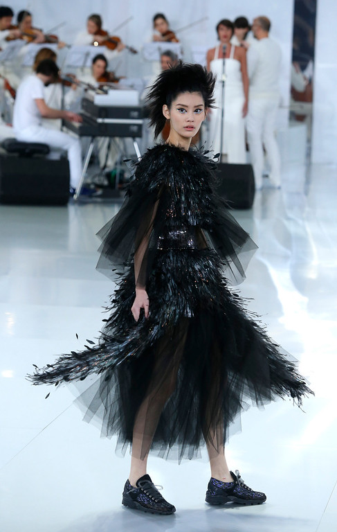 . A model wears a creation by German fashion designer Karl Lagerfeld during Chanel\'s Spring-Summer 2014 Haute Couture fashion collection presented in Paris, Tuesday, Jan.21, 2014. (AP Photo/Jacques Brinon)