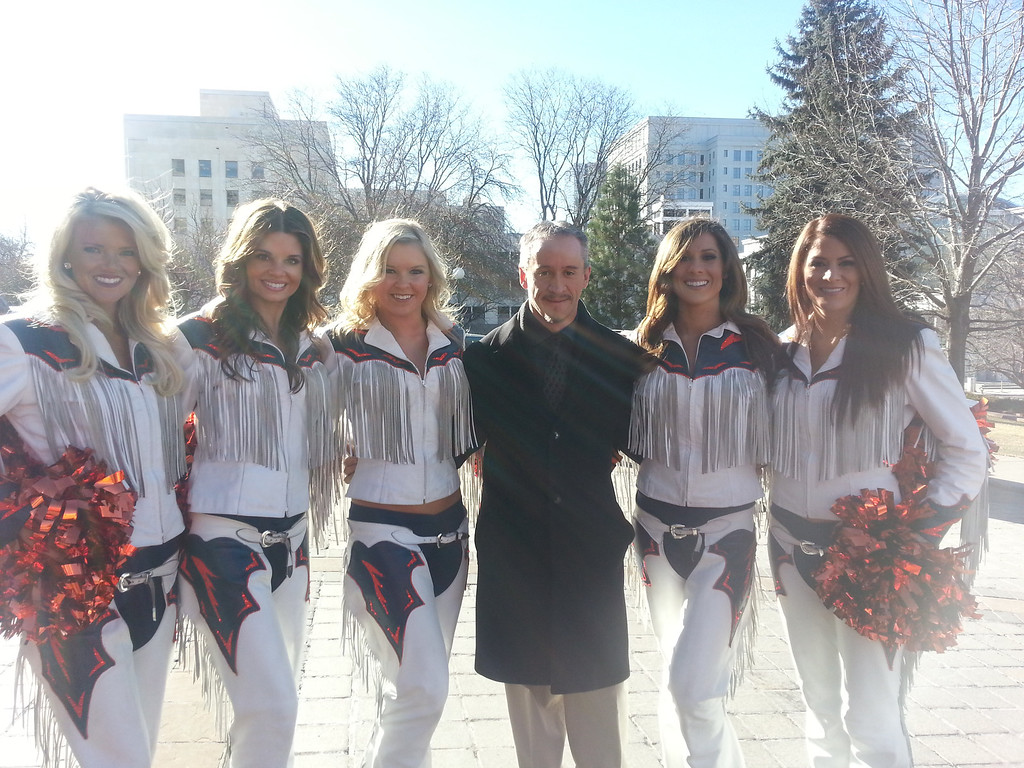 . A luck fan with some lovely Bronco Cheerleaders near the west steps of the State Capitol. Photo by Kathy Zambrano
