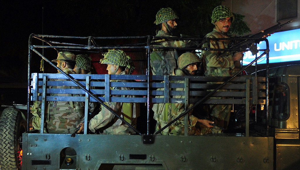 . Pakistani troops move into position at the Karachi airport terminal following an assault by militants in Karachi late on June 8, 2014.  AFP PHOTO/Asif HASSAN/AFP/Getty Images
