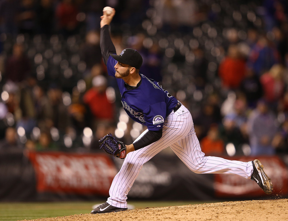 . Relief pitcher Chad Bettis #35 of the Colorado Rockies delivers against the San Francisco Giants at Coors Field on April 21, 2014 in Denver, Colorado.  (Photo by Doug Pensinger/Getty Images)