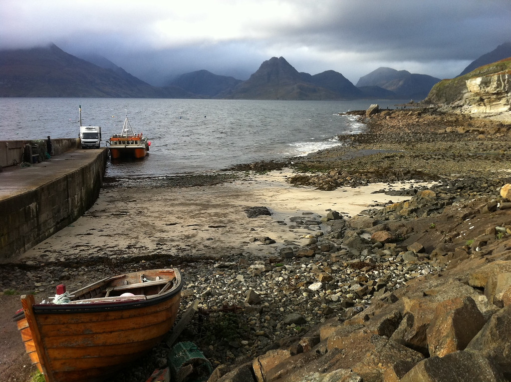 . This October 2013 photo shows the Isle of Skye in Scotland with the Black Cuillin hills in the background. The dramatic peaks of the craggy hills make them appear more imposing than their actual height; the tallest one is 992 meters or 3,255 feet. (AP Photo/Cara Anna)
