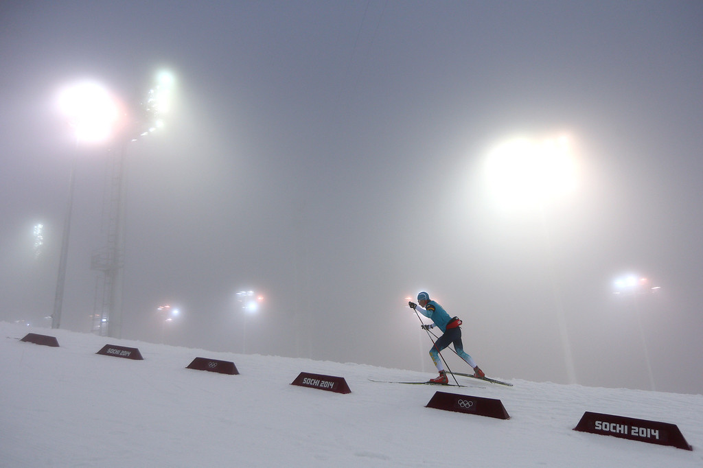 . A Swedish biathlete warms up for in the Men\'s 15 km Mass Start during day nine of the Sochi 2014 Winter Olympics at Laura Cross-country Ski & Biathlon Center on February 16, 2014 in Sochi, Russia.  (Photo by Clive Mason/Getty Images)