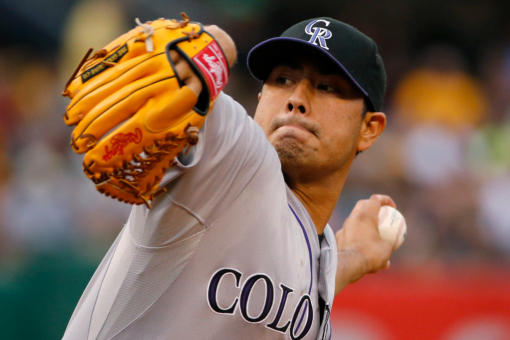 . Colorado Rockies starting pitcher Jorge De La Rosa delivers during the first inning of a baseball game against the Pittsburgh Pirates in Pittsburgh on Friday, July 18, 2014. (AP Photo/Gene J. Puskar)