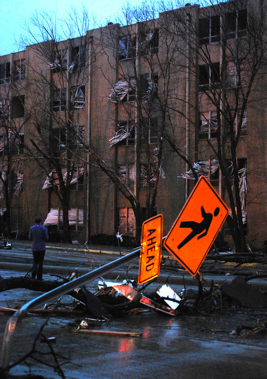 . A women observes the damage to a closed and unoccupied dormitory on the University of Southern Mississippi campus caused by an apparent tornado in Hattiesburg, Miss., Sunday, Feb. 10, 2013. (AP Photo/The Student Printz, Jana Edwards)