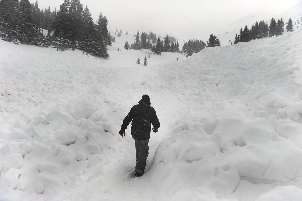 . LOVELAND PASS, CO. - APRIL 20:  A ten-foot thick slab of snow broke free and buried six backcountry thick snowboarders in an avalanche in Sheep Creek Bowl below Loveland Pass Saturday, April 20, 2013.  One survived but the others five died at the scene. Photo By Karl Gehring/The Denver Post