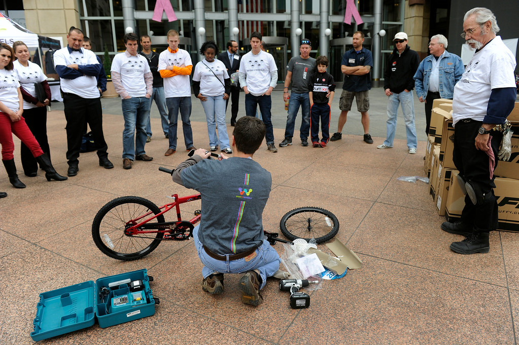 . DENVER, CO - Oct. 11: Outside the Tabor Center downtown, Bruce Bendell, foreground, gives all the volunteers instructions on how to assemble the bikes. Wish for Wheels and its volunteers build and give away over one hundred bikes to kindergarteners and first-graders at Smith Renaissance School in Park Hill. Wish for Wheels says its goal with one-in-five children liven in poverty, is to give as many kids as possible their first brand new bike and helmet. (Photo By Kathryn Scott Osler/The Denver Post)