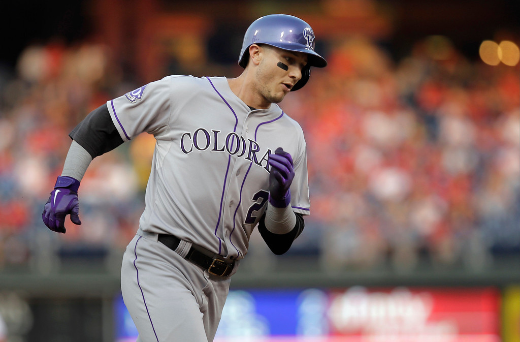 . Colorado Rockies\' Troy Tulowitzki rounds the bases after hitting a home run in the first inning against the Philadelphia Phillies in a baseball game, Tuesday, Aug. 20, 2013, in Philadelphia. (AP Photo/Laurence Kesterson)
