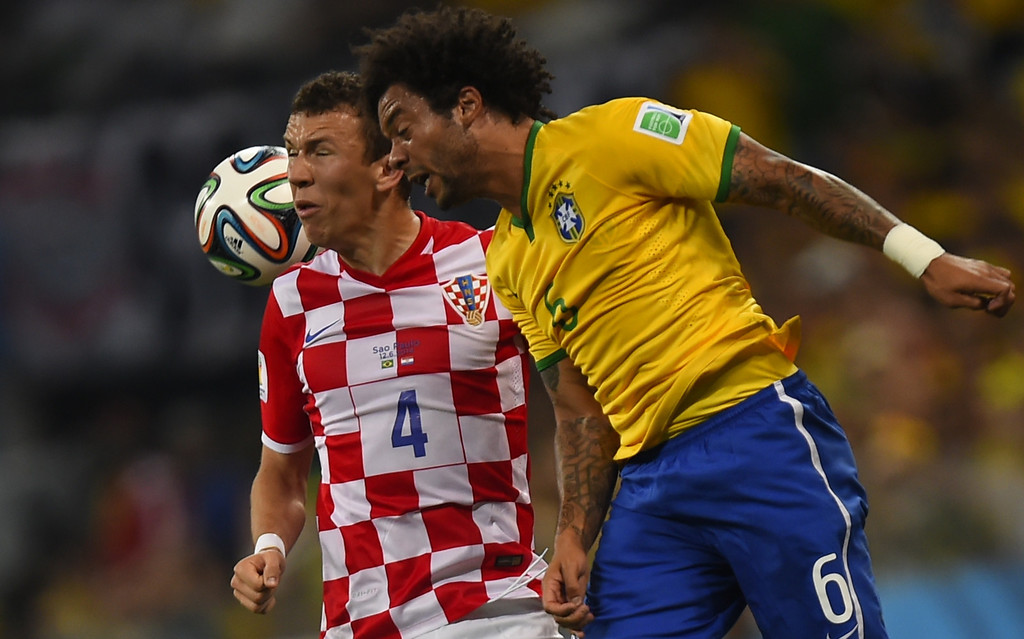 . Croatia\'s midfielder Ivan Perisic (L) and Brazil\'s defender Marcelo vie for the ball during a Group A football match between Brazil and Croatia at the Corinthians Arena in Sao Paulo during the 2014 FIFA World Cup on June 12, 2014. AFP PHOTO / FABRICE COFFRINI/AFP/Getty Images