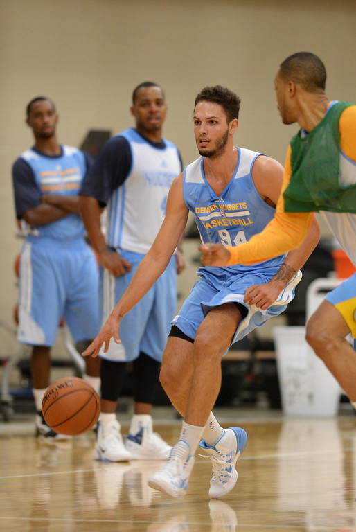 . Evan Fournier of Denver Nuggets (94) controls the ball during the practice. The Denver Nuggets take the court for their first official practice under new coach Brian Shaw at Pepsi Center. Denver, Colorado. October 1, 2013. (Photo by Hyoung Chang/The Denver Post)