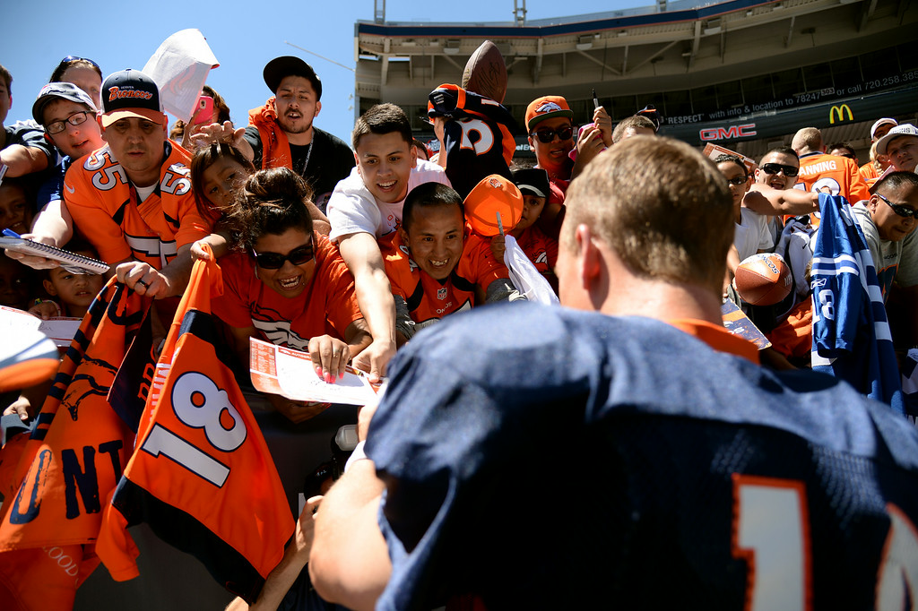 . Peyton Manning of Denver Broncos (18) signs autographs for the fans  after the Broncos scrimmage at Sports Authority Field at Mile High. Denver, Colorado. August 02. 2014. (Photo by Hyoung Chang/The Denver Post)