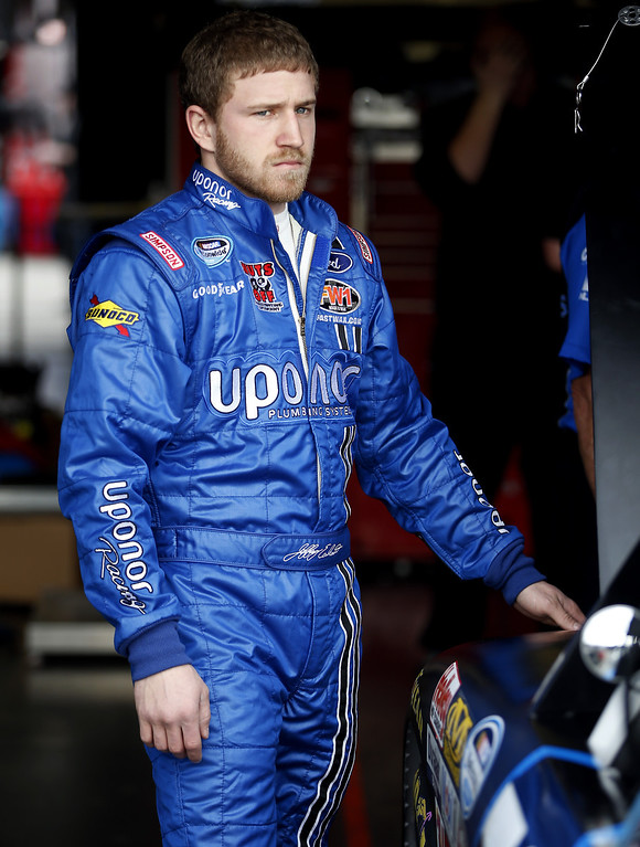 . Jeffrey Earnhardt, driver of the #79 Uponor Ford, stands in the garage during practice for the NASCAR Nationwide Series DRIVE4COPD 300 at Daytona International Speedway on February 21, 2013 in Daytona Beach, Florida.  (Photo by Chris Graythen/Getty Images)