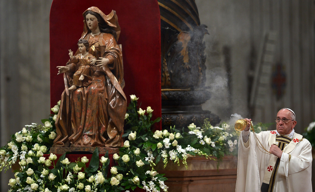 . Pope Francis swings a censer next to a statue of the Virgin Mary during the Easter Vigil at the St Peter basilica in Vatican. Easter Vigil, also called the Paschal Vigil is a service held in traditional Christian churches as the first official celebration of the Resurrection of Jesus.  AFP PHOTO / FILIPPO MONTEFORTE/AFP/Getty Images