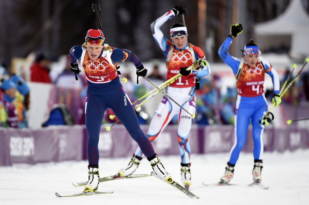 . (LtoR) Norway\'s Tora Berger, Czech Republic\'s Veronika Vitkova and Italy\'s Dorothea Wierer  compete in the Biathlon mixed 2x6 km + 2x7,5 km Relay at the Laura Cross-Country Ski and Biathlon Center during the Sochi Winter Olympics on February 19, 2014 in Rosa Khutor near Sochi.  AFP PHOTO / ODD  ANDERSEN/AFP/Getty Images