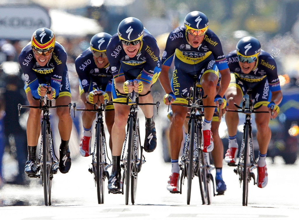 . Team Saxo-Tinkoff riders cycle on the Promenade des Anglais during the 25km team time-trial fourth stage of the centenary Tour de France cycling race in Nice July 2, 2013.      REUTERS/Jean-Paul Pelissier