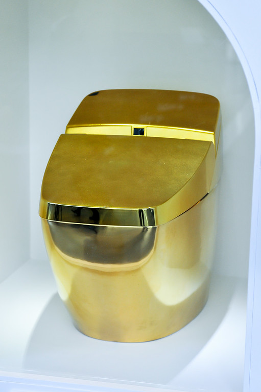 """. TOKYO, JAPAN - JULY 01:  A gold toilet is displayed during the \""""Toilet!? Human Waste and Earth\'s Future\"""" exhibition at The National Museum of Emerging Science and Innovation - Miraikan on July 1, 2014 in Tokyo, Japan. The exhibition focuses on how the toilet has changed our daily lives and discovers what the most environment-friendly and ideal toilet is.  (Photo by Keith Tsuji/Getty Images)"""