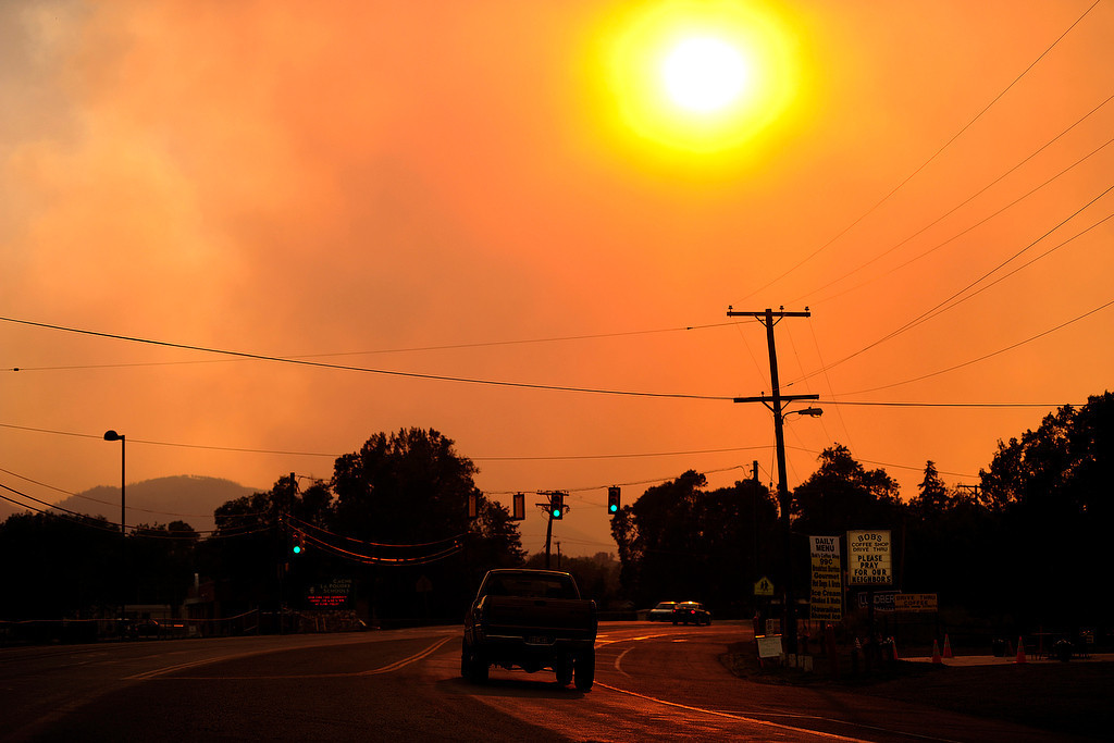 . A truck drives through Laporte as the High Park Fire burns west of Fort Collins on Sunday, June 17, 2012. AAron Ontiveroz, The Denver Post
