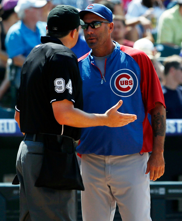 . Chicago Cubs manager Dale Sveum, right, argues call with home plate umpire Lance Barrett, left, while facing the Colorado Rockies in the fourth inning of a baseball game in Denver, Sunday, July 21, 2013. (AP Photo/David Zalubowski)