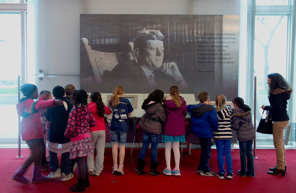 ". Children gather around a a multimedia display ""John F. Kennedy His Life and Legacy\"" in the grand foyer at the John F. Kennedy Center for the Performing Arts in Washington, Friday, Nov. 22, 2013, on the 50th anniversary of President John F. Kennedy\'s death. (AP Photo/Carolyn Kaster)"