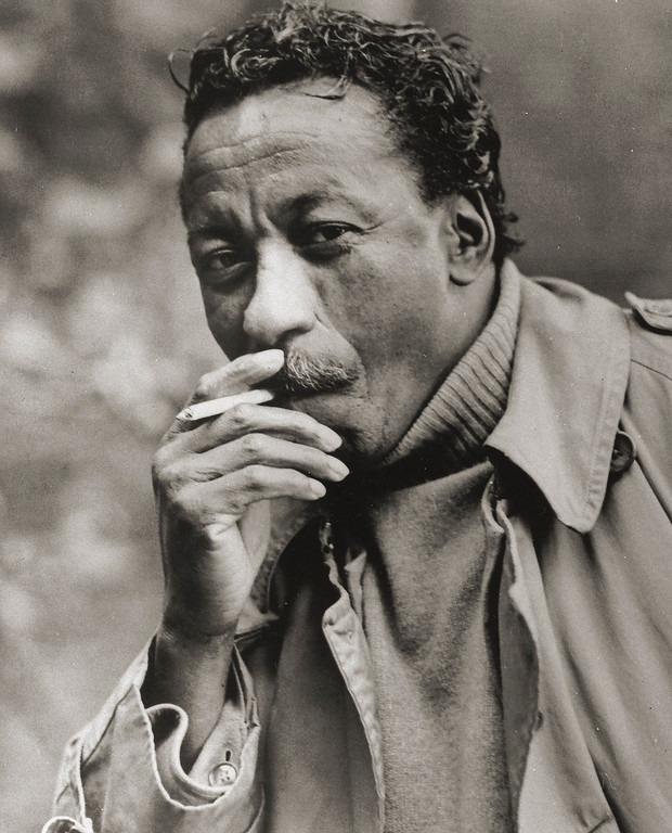 """. This 1966 photo shows photographer Gordon Parks. Parks, who captured the struggles and triumphs of black America as a photographer for Life magazine and then became Hollywood\'s first major black director with \""""The Learning Tree\"""" and the hit \""""Shaft,\"""" died March 7, 2006. He was 93. (AP Photo/Adelaide de Menil)"""