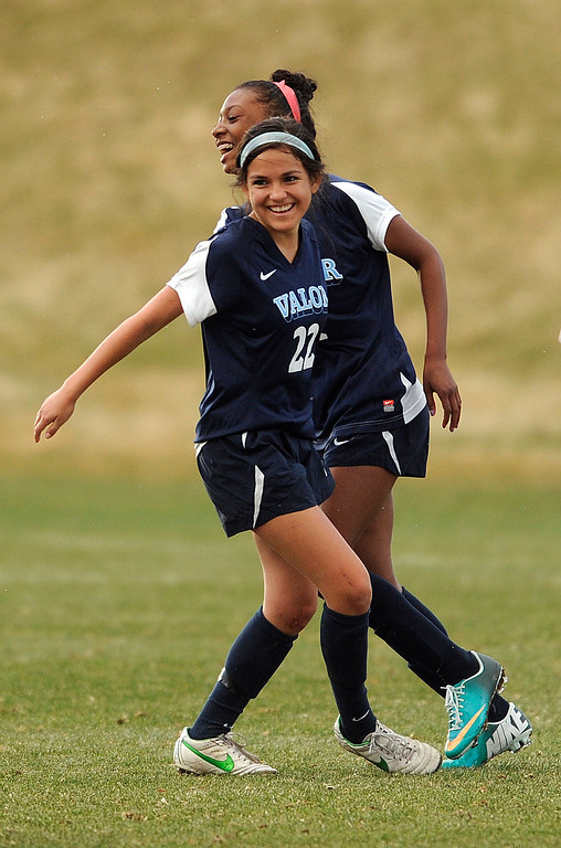 . PARKER, CO. - APRIL 2: Valor freshman forward Cydney Billups (4) got an assist on the goal punched in by freshman midfielder Amanda Lopez (22) in the first half. The Valor Christian High School girl\'s soccer team defeated Golden 4-1 Wednesday night, April 3, 2013.  Photo By Karl Gehring/The Denver Post)