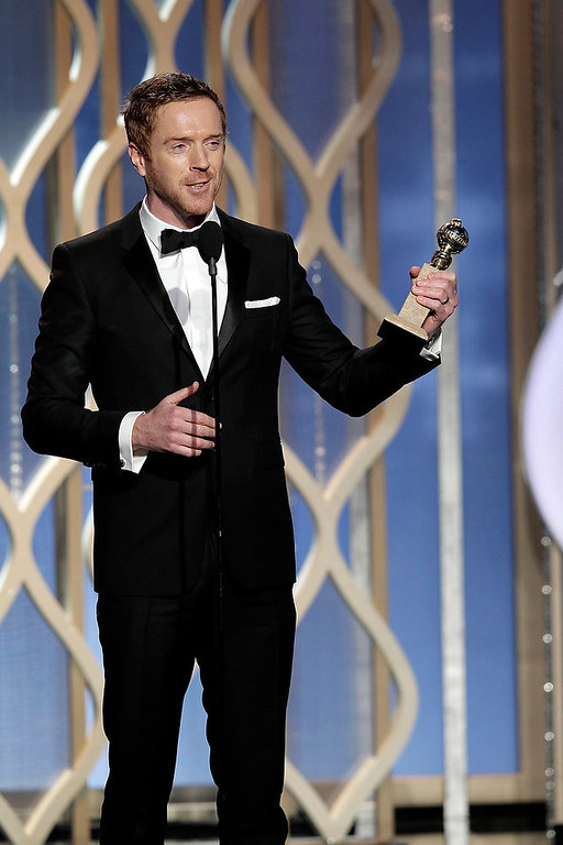 ". This image released by NBC shows Damian Lewis, winner of the award for best actor in a TV drama series for his role in ""Homeland,\"" on stage during the 70th Annual Golden Globe Awards held at the Beverly Hilton Hotel on Sunday, Jan. 13, 2013, in Beverly Hills, Calif. (AP Photo/NBC, Paul Drinkwater)"