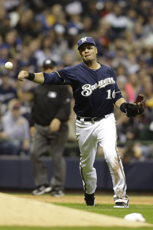 . MILWAUKEE, WI - APRIL 3:  Third baseman Aramis Ramirez #16 of the Milwaukee Brewers makes the throw to first base to get Dexter Fowler of the Colorado Rockies out in the top of the seventh inning at Miller Park on April 3, 2013 in Milwaukee, Wisconsin. (Photo by Mike McGinnis/Getty Images)