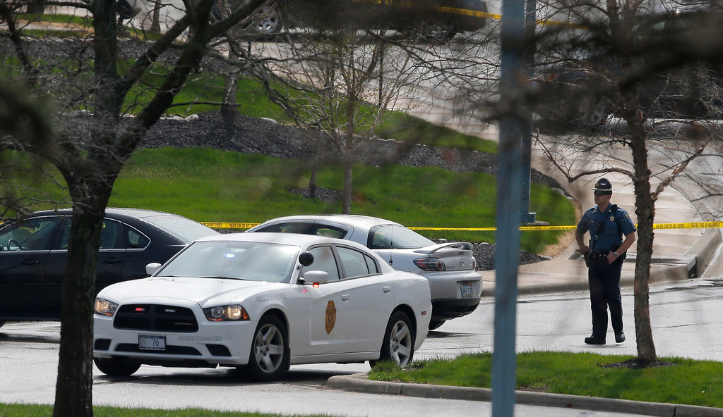 . A Kansas State Trooper stands near the location of a shooting at the Jewish Community Center in Overland Park, Kan., Sunday, April 13, 2014. (AP Photo/Orlin Wagner)