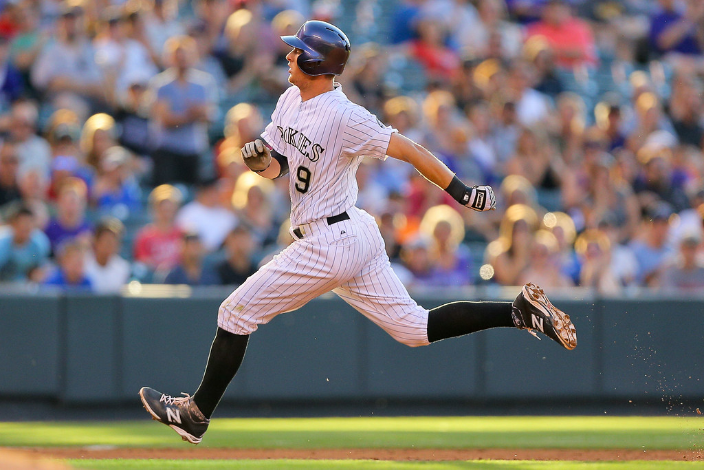 . DENVER, CO - JULY 22:  DJ LeMahieu #9 of the Colorado Rockies strides into third base with an RBI triple during the second inning against the Washington Nationals at Coors Field on July 22, 2014 in Denver, Colorado.  (Photo by Justin Edmonds/Getty Images)