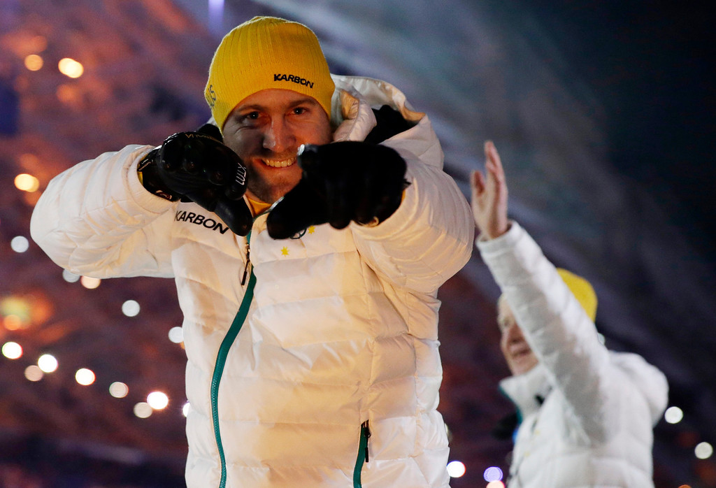 . A member of the Australian team cheers as he enters the stadium during the opening ceremony of the 2014 Winter Olympics in Sochi, Russia, Friday, Feb. 7, 2014. (AP Photo/Patrick Semansky)