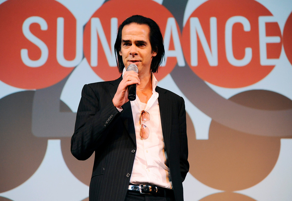 ". Musician Nick Cave, subject of the documentary film ""20,000 Days on Earth,\"" takes questions from the audience following the premiere of the film at the Egyptian Theatre, during the 2014 Sundance Film Festival, Monday, Jan. 20, 2014, in Park City, Utah. (Photo by Chris Pizzello/Invision/AP)"