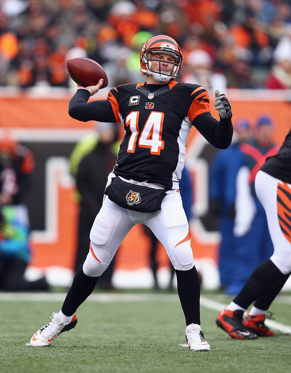 . Andy Dalton #14 of the Cincinnati Bengals throws the ball during the NFL game against the Indianapolis Colts  at Paul Brown Stadium on December 8, 2013 in Cincinnati, Ohio.  (Photo by Andy Lyons/Getty Images)