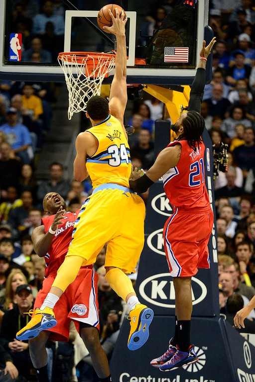 . Los Angeles Clippers power forward Lamar Odom (7) fouls Denver Nuggets center JaVale McGee (34) during the second half of the Nugget\'s 92-78 win at the Pepsi Center on Tuesday, January 1, 2013. AAron Ontiveroz, The Denver Post