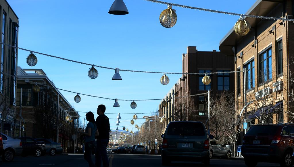 . Pedestrians cross Alaska Drive at Belmar in Lakewood, CO, January 22, 2013. (Photo By Craig F. Walker / The Denver Post)