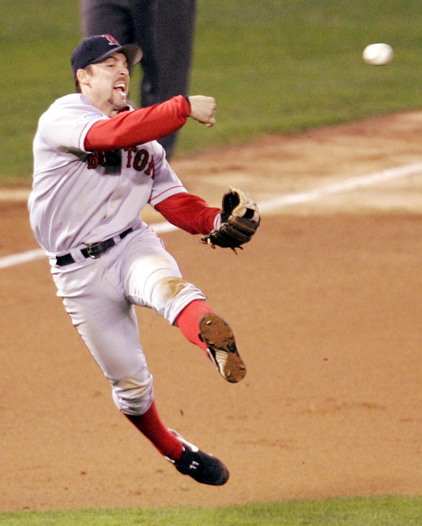 . Boston Red Sox third baseman Bill Mueller throws out St. Louis Cardinals\' Scott Rolen at first in the fourth inning of Game 3 of the World Series Tuesday, Oct. 26, 2004, in St. Louis. (AP Photo/Mark Humphrey)