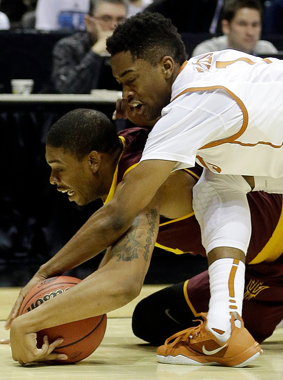 . Arizona State guard Jermaine Marshall and Texas guard Isaiah Taylor battle for a loose ball during the first half of a second round NCAA college basketball tournament game Thursday, March 20, 2014, in Milwaukee. (AP Photo/Morry Gash)