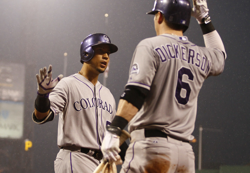 . PITTSBURGH, PA - JULY 19: Carlos Gonzalez #5 of the Colorado Rockies celebrates with Corey Dickerson #6 after hitting a two run home run in the seventh inning against the Pittsburgh Pirates during the game at PNC Park July 19, 2014 in Pittsburgh, Pennsylvania. (Photo by Justin K. Aller/Getty Images)