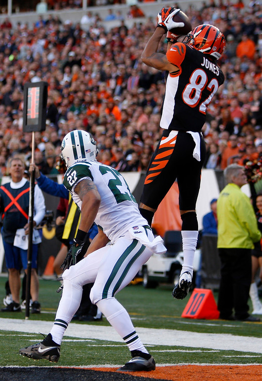 . Cincinnati Bengals wide receiver Marvin Jones (82) catches a nine-yard touchdown pass against New York Jets cornerback Dee Milliner (27) in the first half of an NFL football game, Sunday, Oct. 27, 2013, in Cincinnati. (AP Photo/David Kohl)
