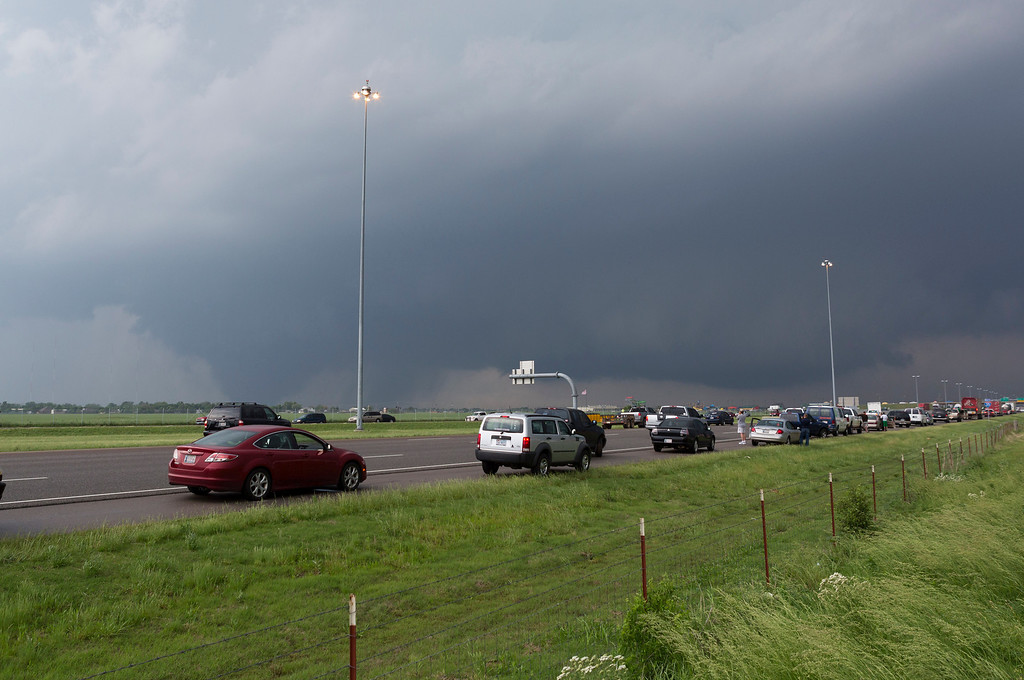 . A tornado moves through Moore, Okla. as northbound traffic on Interstate 35 stops at Indian Hills Road on Monday, May 20, 2013. (AP Photo/Alonzo Adams)
