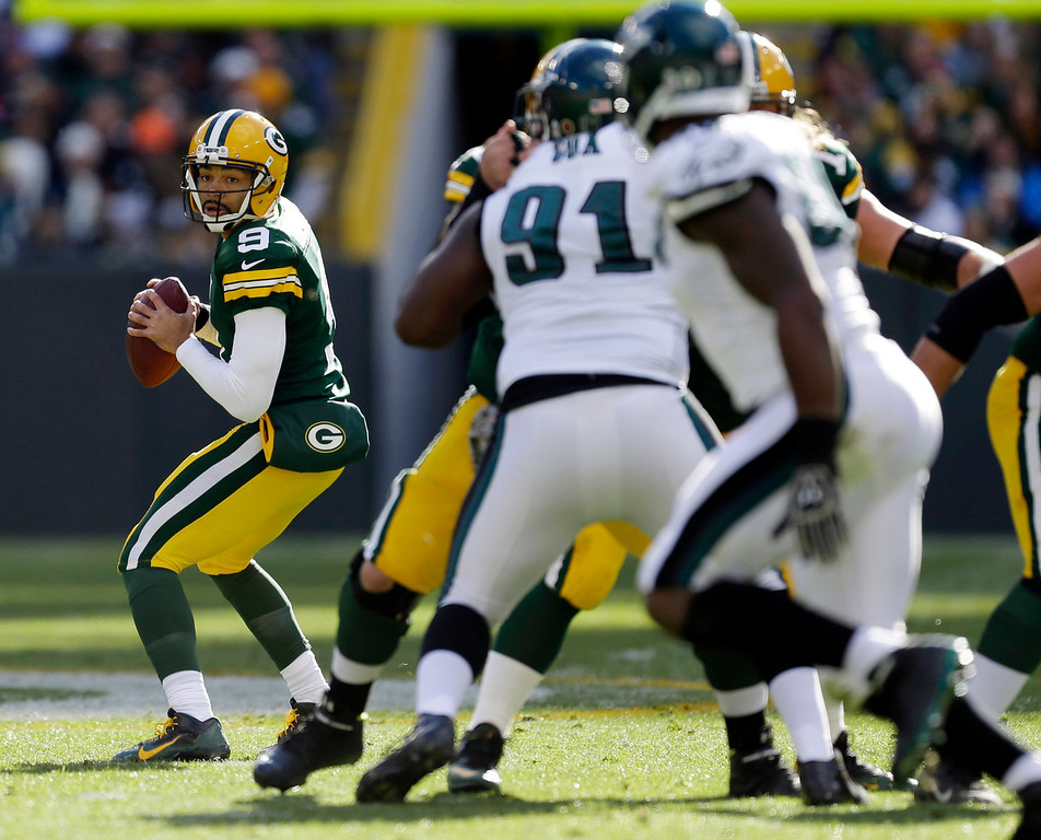 . Green Bay Packers quarterback Seneca Wallace looks to pass during the first half of an NFL football game against the Philadelphia Eagles Sunday, Nov. 10, 2013, in Green Bay, Wis. Wallace left the game with an injury. (AP Photo/Mike Roemer)
