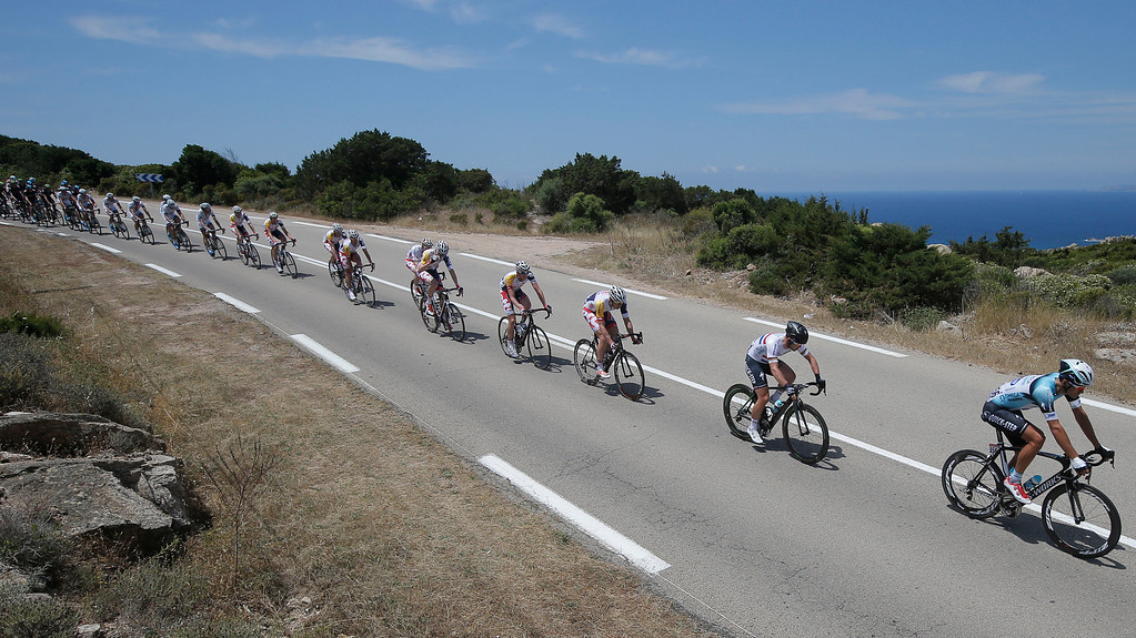 . Britain\'s sprinter Mark Cavendish, second right, rides in the pack along the coast line of the Mediterranean Sea during the first stage of the 100th edition of the Tour de France cycling race over 213 kilometers (133 miles) with start in Porto Vecchio and finish in Bastia, Corsica island, France, Saturday June 29, 2013.(AP Photo/Laurent Cipriani)