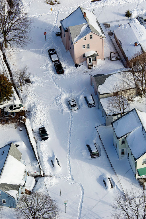 . Neighborhoods and cars are buried in snow near New Haven, Conn., Sunday, Feb. 10, 2013, in the aftermath of a storm that hit Connecticut and much of the New England states. (AP Photo/Craig Ruttle)