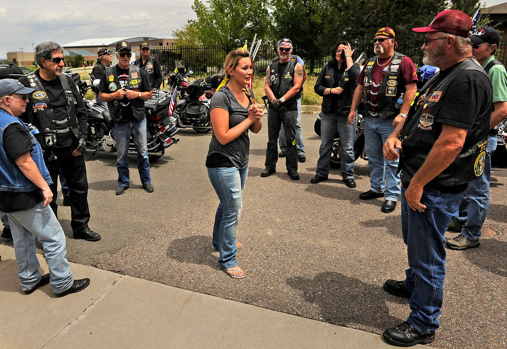 . Chantel Blunk thanks the Patriot Guard Riders outside Apollo and Three Tree Chapel in Littleton on Friday, July 27, 2012. The Patriot Guard Riders took part in the procession to Denver International Airport where Blunk\'s body was flown to Reno, Nevada for his full military funeral.