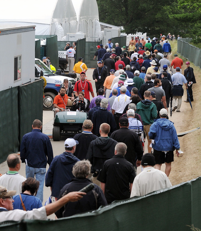 . A rain delayed part of the first round of the 113th US Open Golf Championship, at Merion Golf Club in Haverford.  Fans are evacuated from the course, as severe storms move in. Photo by Tom Kelly IV Daily Local News