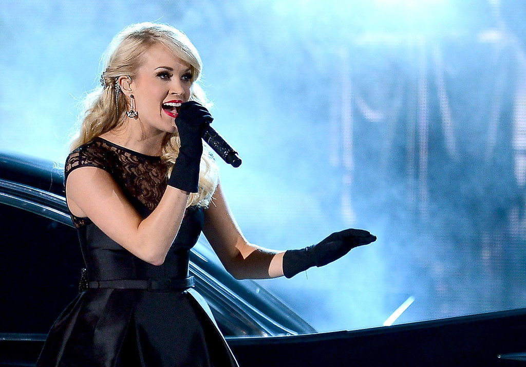. Musician Carrie Underwood performs onstage during the 48th Annual Academy of Country Music Awards at the MGM Grand Garden Arena on April 7, 2013 in Las Vegas, Nevada.  (Photo by Ethan Miller/Getty Images)