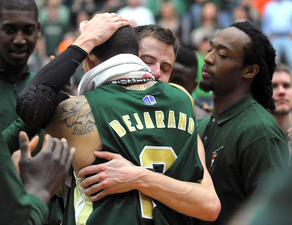 . Colorado State senior Wes Eikmeier and teammate Daniel Bejarano hug following an NCAA college basketball game againt Nevada on Saturday, March 9, 2013, in Fort Collins, Colo. (AP Photo/Fort Collins Coloradoan, Dawn Madura)