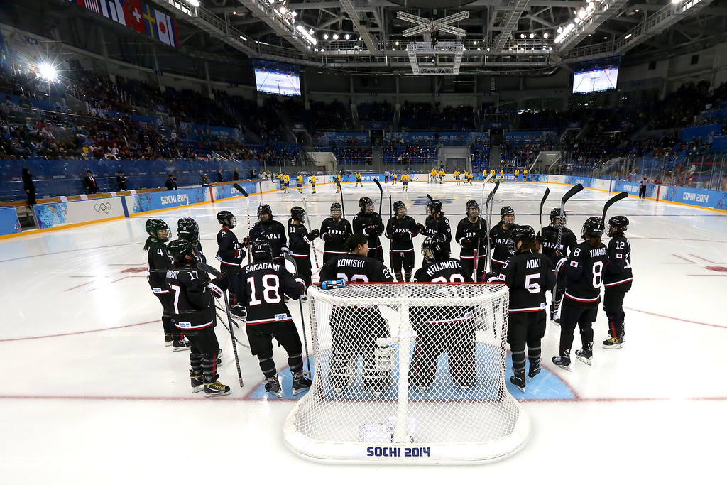 . SOCHI, RUSSIA - FEBRUARY 09:  Members of the Japan ice hockey team form a huddle prior to the Women\'s Ice Hockey Preliminary Round Group B Game on day two of the Sochi 2014 Winter Olympics at Shayba Arena on February 9, 2014 in Sochi, Russia.  (Photo by Martin Rose/Getty Images)