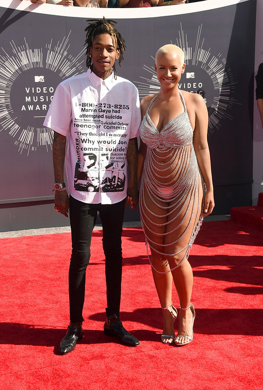 . Rapper Wiz Khalifa (L) and model Amber Rose attend the 2014 MTV Video Music Awards at The Forum on August 24, 2014 in Inglewood, California.  (Photo by Jason Merritt/Getty Images for MTV)